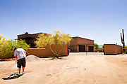 "22 MAY 2011 - SCOTTSDALE, AZ:  A man who refused to talk to the media puts a ""No Trespassing"" sign in front of a home reportedly owned by Sarah Palin in Scottsdale, AZ. According to the Arizona Republic, Sarah Palin and her husband Todd Palin, bought the 8,000 square foot home for $1.695 million cash. The newspaper said the Palin's name does not appear on the paperwork and the home was bought by Safari Investments LLC out of Delaware. The paper said the deal ""appears designed to cloak the identity of a high-profile buyer."" The home has six bedrooms, five bathrooms, a six car garage, swimming pool, spa, home theater, wine cellar and children's ""jungle gym"" in the backyard. The home is surrounded by a tall wall with an electronic gate. Phoenix TV stations have reported that a black SUV with Alaska license plates has been seen entering and leaving the compound. People in the house have refused to comment on who owns the home. Neither Palin nor her husband have been seen at the home since news of the sale broke Saturday, May 21.   Photo by Jack Kurtz"