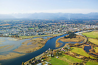An aerial view of the Comox estuary, Puntledge River and the city of Courtenay shows the close proximity of rich agricultural land.  Comox Valley, Vancouver Island, British Columbia, Canada.