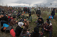 Between Idomeni, Greece &amp; Moin, Macedonia - 14.03.2016      <br /> <br /> Many refugees left the camp in Idomeni on the Greek- Macedonian border where they are partially stranded for weeks . With a March of Hope and they went to the point at which ended the Macedonian border fence and crossed the border there. Their path led through rough terrain, including crossing a cold river. In the Macedonian village Moin heavily armed police and military forces stopped the refugees. Present journalists were immediately taken into custody while the refugees were driven away in military transport.<br /> <br /> Zahlreiche Fluechtlinge verlie&szlig;en das Camp in Idomeni an der griechisch-mazedonischen Grenze wo sie teilweise seit Wochen gestrandet sind. Mit einem March of Hope zogen sie zu dem Punkt an dem der mazedonische Grenzzaun endete und &uuml;berquerten dort die Grenze. Ihr Weg fuehrte durch unwegsames Gelaende inklusive eines kalten Flusses. In dem mazedonischen Dorf Moin stoppten schwer bewaffnete Polizisten und Militaers den Fliehenden. Anwesende Journalisten wurde umgehend in Gewahrsam genommen waehrend die Fluechtlinge wurde in Militaertransportern weggefahren. <br /> <br /> Foto: Bjoern Kietzmann