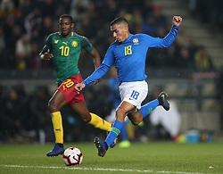 Brazil's Allan (right) and Cameron's Arnaud Djoum battle for the ball