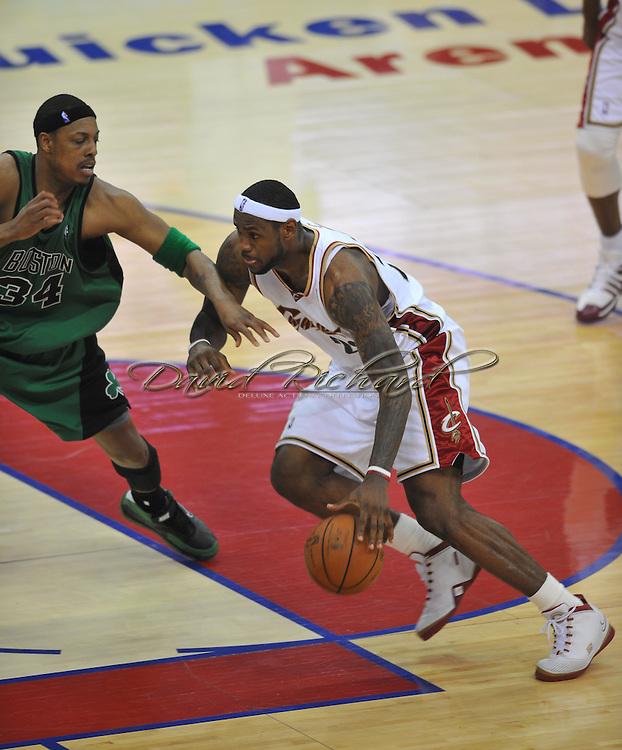 LeBron James dribbles past Paul Pierce.