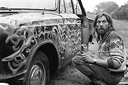 Hank painting a site car, at Glastonbury, 1989.