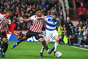 Queens Park Rangers Midfielder Luke Freeman (7) and Brentford Defender Julian Jeanvier (23) battle for the ball during the EFL Sky Bet Championship match between Brentford and Queens Park Rangers at Griffin Park, London, England on 2 March 2019.