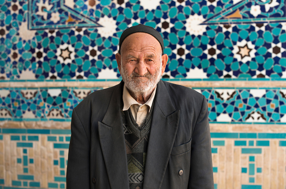Portrait of an old man in front a mosque