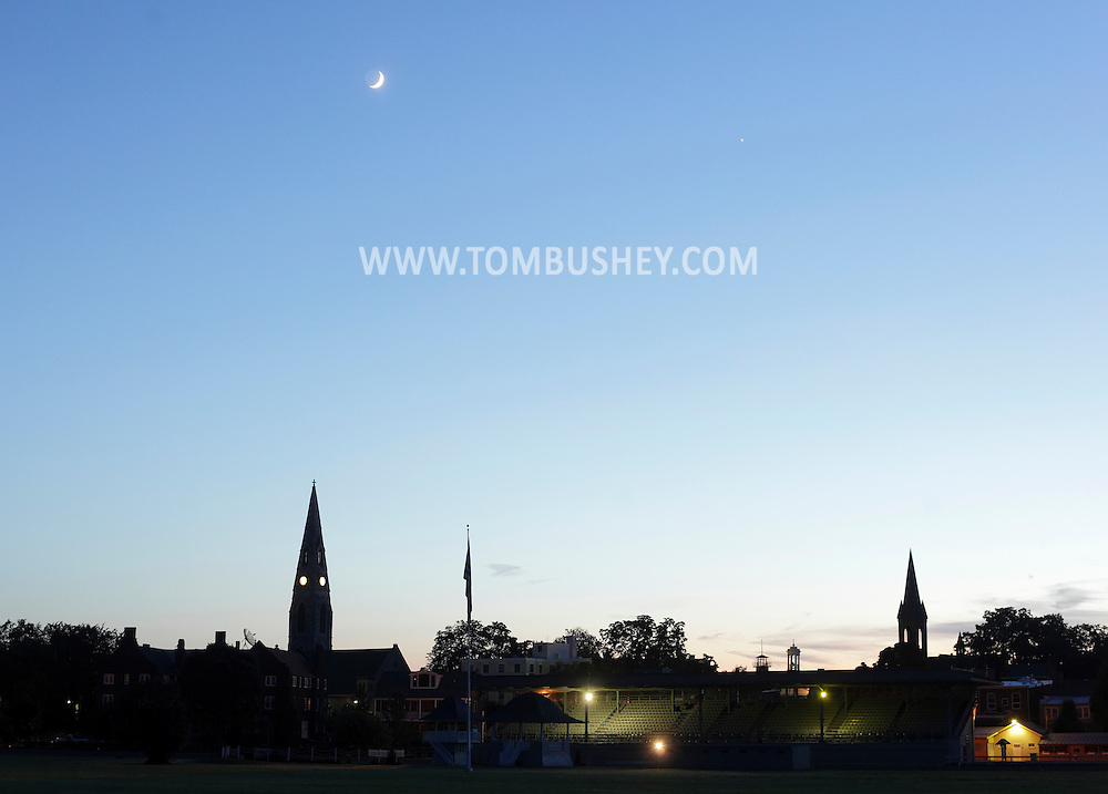 Goshen, New York - A crescent moon and Venus shine above church steeples at twilight on June 15, 2010.