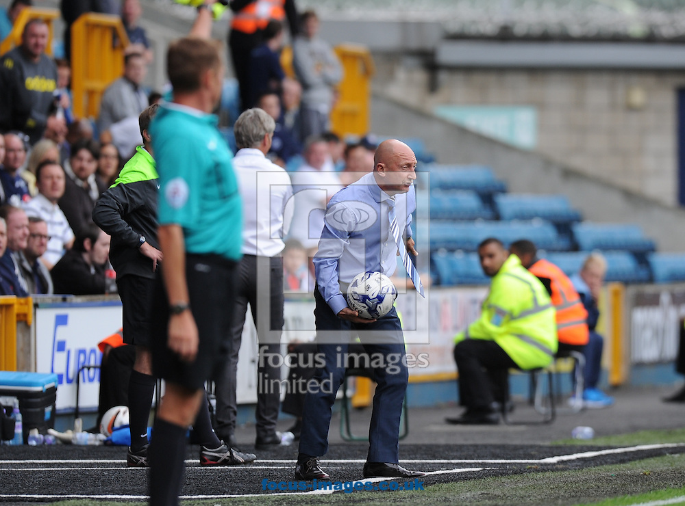 Manager Ian Holloway of Millwall throws the ball back during the Sky Bet Championship match at The Den, London<br /> Picture by Alan Stanford/Focus Images Ltd +44 7915 056117<br /> 30/08/2014
