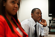 Brandon Foole and Adrienne Gosset listen to a presentation during a meeting of the Ohio University College of Business Junior Executive Board. Photo by: Ross Brinkerhoff. College of Business Junior Executive Board People Students Student Groups
