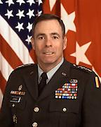 15683TRADOC Commander, Gen. Kevin Byrnes copy H&S ROTC w/flag