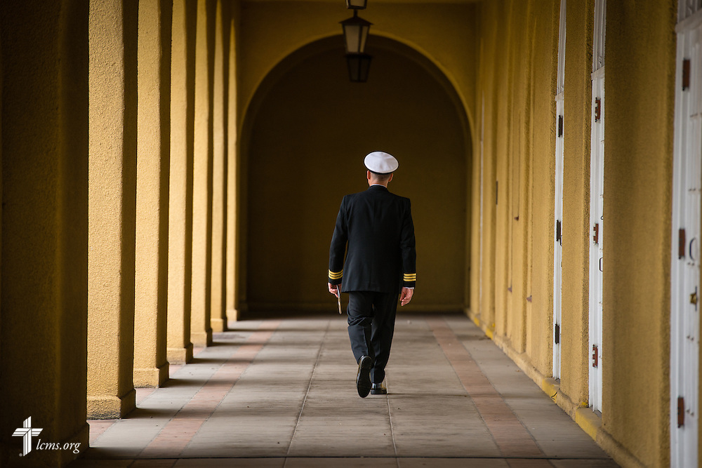 Cmdr. Charles E. Varsogea, chaplain at the Marine Corps Recruit Depot, leaves the recruit graduation ceremony on  Friday, Jan. 30, 2015,  at the depot in San Diego, Calif. LCMS Communications/Erik M. Lunsford