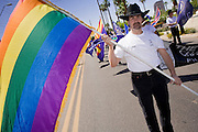 14 APRIL 2007 -- PHOENIX, AZ: A man carries the Gay Pride flag at the annual Gay Pride Parade in Phoenix, AZ.  Photo by Jack Kurtz