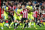 Brentford (19) Romaine Sawyers, Brentford (9) Neal Maupay, Derby County (15) Bradley Johnson  during the EFL Sky Bet Championship match between Brentford and Derby County at Griffin Park, London, England on 26 September 2017. Photo by Sebastian Frej.
