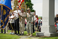 Members of the NH American Legion Color Guard stand at attention for the playing of taps during Monday's Memorial Day service at Veteran's Square.  (Karen Bobotas/for the Laconia Daily Sun)