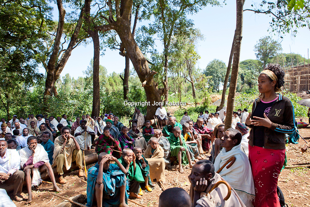 A young midwife teaches men about early marriage and obstructed labor at a church service in rural Ethiopia
