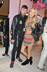 MARY CHARTERIS and ROBIE FURZE at a party to celebrate the launch of Louise Gray's make-up and clothing collections for Topshop held at Topshop Edited, 286 Regent Street, London on 22nd August 2012.