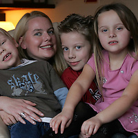 Millenium twins Jay (left) and Jordan Doherty from Letham near Forfar who are about to celebrate their fifth birthday, pictured with their mother Zenna and older brother Struan (8)<br /><br />Picture by Graeme Hart.<br />Copyright Perthshire Picture Agency<br />Tel: 01738 623350  Mobile: 07990 594431