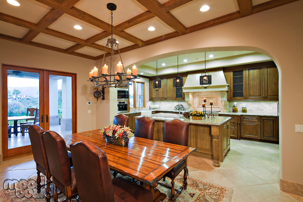 Dining table near kitchen in luxury mansion