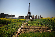 HANGZHOU, CHINA - MARCH 21: (CHINA OUT) <br /> <br /> Replica Of Paris In China<br /> <br /> a replica of The Eiffel Tower standing at 108 metres at Tianducheng residential community, also known as a knockoff of Paris, on March 21, 2014 in Hangzhou, Zhejiang Province of China. Tianducheng is developed by Zhejiang Guangsha Co. Ltd.. The construction began in 2007 with a replica of the Eiffel Tower and Parisian houses, and it is expected to be completed by 2015.    <br /> ©Exclusivepix