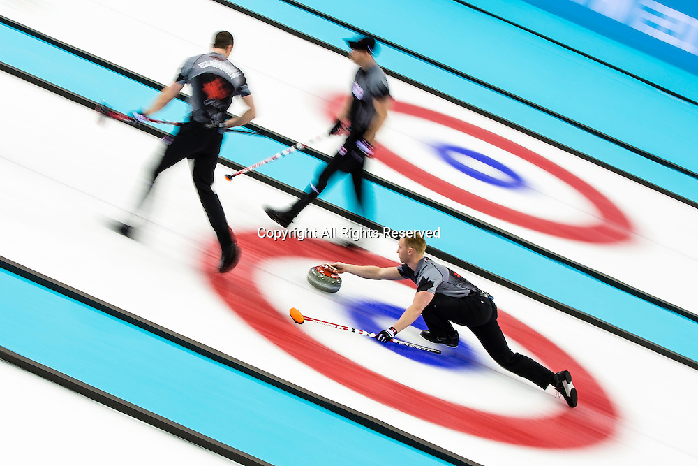 21.02.2014 Sochi, Krasnodar Krai, Russia.   Canada skip Brad JACOBS delivers a stone during the Gold Medal Game of the Men's Curling competition from the Ice Cube Curling Centre, Coastal Cluster  - XXII Olympic Winter Games