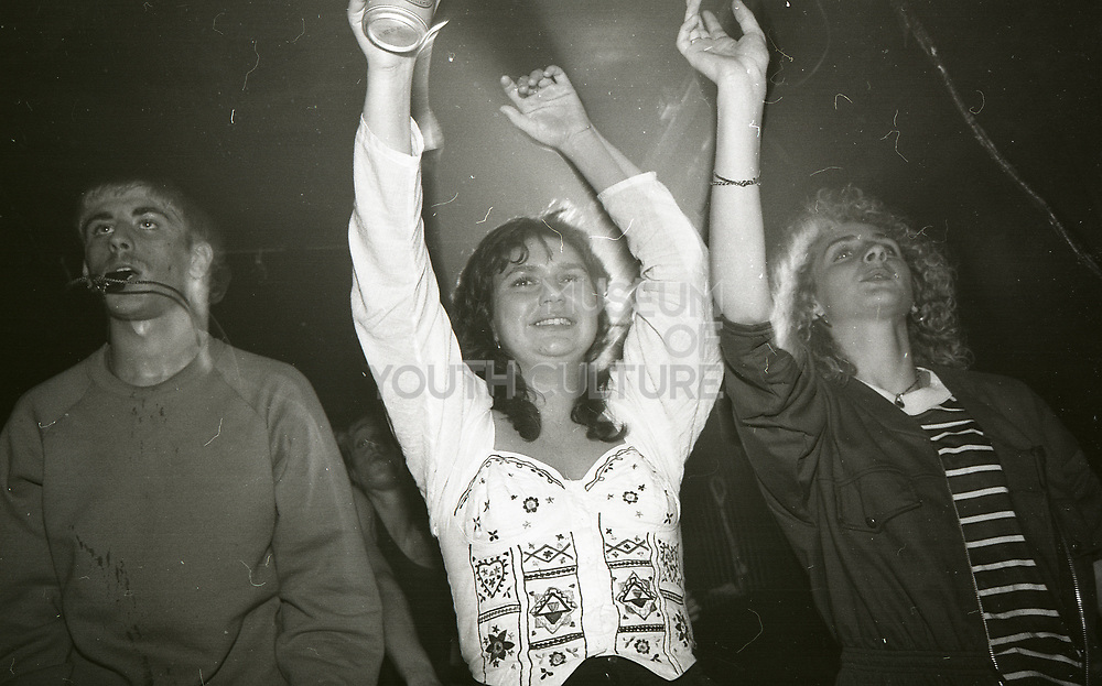 Ravers putting up their hands high, The Boardwalk, Manchester, 1991.