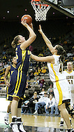 08 February 2007: Michigan center Krista Phillips (25) tries to shoot over Iowa center Stacy Schlapkohl (40) in Iowa's 66-49 win over Michigan at Carver-Hawkeye Arena in Iowa City, Iowa on February 8, 2007.