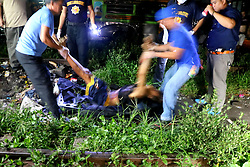 September 30, 2016 - Philippines - Members of S.O.C.O. (Scene of the Crime Operatives) process the crime scene of un-identified suspect after was pin down by the members of Philippine National Police during the drugs operation in Brgy. 36, Maypajo, Caloocan City on September 30, 2016. The total suspect are 6 persons, (3 died during the operation and 3 was arrested). The operation is part of the intense campaign by the government versus illegal drugs. (Credit Image: © Gregorio B. Dantes Jr/Pacific Press via ZUMA Wire)