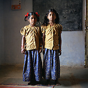 "Andhra Pradesh, India has the largest child labour force in the world. MVF Foundation is an Ngo that works in the field of child labour in south of Idnia. Today  MVF works in 491 villages in Ranga Reddy district of Andhra Pradesh. .It has so far withdrawn 100,000 children out of work and retained them in schools. .Suvarna and Renika, 9 and 8 years old. they are sister and they both used to work in a mine stone close to piduguralla. They are in the mvf program since 3 months.."" that' s onother world, we like here and we don twant to go back "" they said.."