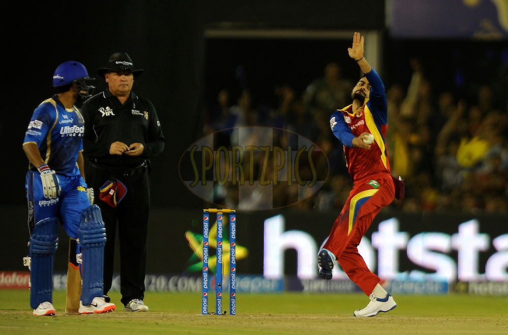 Virat Kohli captain of Royal Challengers Bangalore bowls during match 22 of the Pepsi IPL 2015 (Indian Premier League) between The Rajasthan Royals and The Royal Challengers Bangalore held at the Sardar Patel Stadium in Ahmedabad , India on the 24th April 2015.<br /> <br /> Photo by:  Pal Pillai / SPORTZPICS / IPL