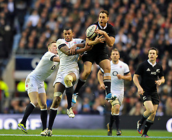 Courtney Lawes (England) and Israel Dagg (New Zealand) compete for the ball in the air - Photo mandatory by-line: Patrick Khachfe/JMP - Tel: Mobile: 07966 386802 16/11/2013 - SPORT - RUGBY UNION -  Twickenham Stadium, London - England v New Zealand - QBE Autumn Internationals.
