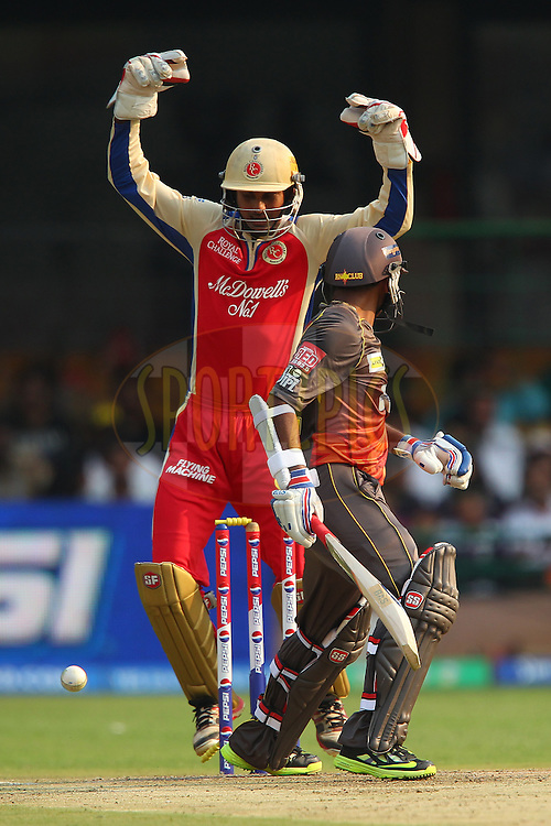 Parthiv Patel is bowled by Muttiah Muralitharan as Arun Karthik celebrates during match 9 of of the Pepsi Indian Premier League between The Royal Challengers Bangalore and The Sunrisers Hyderabad held at the M. Chinnaswamy Stadium, Bengaluru  on the 9th April 2013..Photo by Ron Gaunt-IPL-SPORTZPICS   ..Use of this image is subject to the terms and conditions as outlined by the BCCI. These terms can be found by following this link:..http://www.sportzpics.co.za/image/I0000SoRagM2cIEc