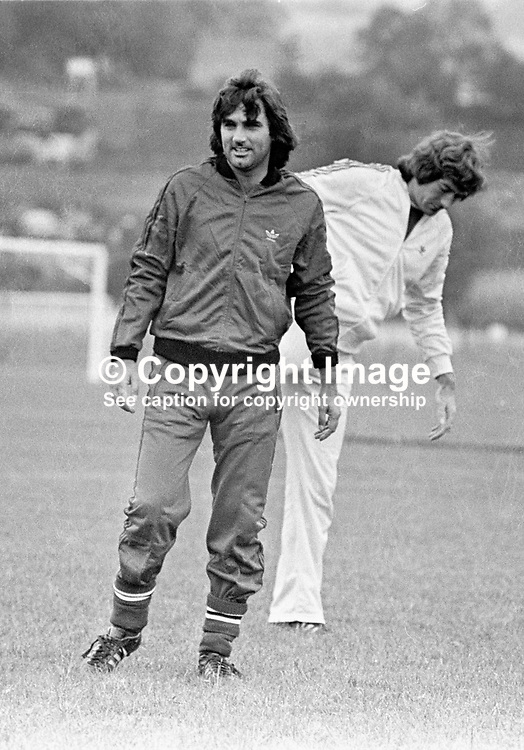Belfast-born footballer George Best during a training session prior to the N Ireland International team playing Iceland at Windsor Park, Belfast. Also in the picture is Pat Jennings, N Ireland's goalkeeper. 19770920182b<br /> <br /> Copyright Image from Victor Patterson, 54 Dorchester Park, Belfast, UK, BT9 6RJ<br /> <br /> t1: +44 28 9066 1296 (from Rep of Ireland 048 9066 1296)<br /> t2: +44 28 9002 2446 (from Rep of Ireland 048 9002 2446)<br /> m: +44 7802 353836<br /> <br /> victorpattersonbelfast@gmail.com<br /> victorpatterson@me.com<br /> <br /> www.victorpatterson.com<br /> <br /> Please see my Terms and Conditions of Use at https://www.victorpatterson.com/page2<br /> It is IMPORTANT that you familiarise yourself with them.<br /> <br /> Images used on the Internet incur an additional cost and must be visibly watermarked i.e. © Victor Patterson within the body of the image and copyright metadata must not be deleted. Images used on the Internet have a size restriction of 4kbs and are chargeable at rates available at victorpatterson.com.<br /> <br /> This image is available only for the use of the download recipient i.e. television station, newspaper, magazine, book publisher, etc, and must not be passed on to any third party. It is also downloaded on condition that each and every usage is notified within 7 days to victorpatterson@me.com<br /> <br /> The right of Victor Patterson (or the named photographer) to be identified as the author is asserted in accordance with The Copyright Designs And Patents Act (1988). All moral rights are asserted.