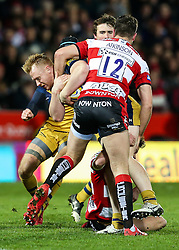Will Hurrell of Bristol Rugby is tackled by Mark Atkinson of Gloucester Rugby - Rogan Thomson/JMP - 03/12/2016 - RUGBY UNION - Kingsholm Stadium - Gloucester, England - Gloucester Rugby v Bristol Rugby - Aviva Premiership.