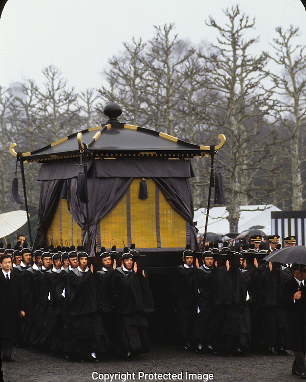 Pallbearers carry the casket of Emperor Hirohito at his funeral on February 24 1989..Photograph by Dennis Brack bb 27