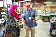 Milpitas Post reporter Aliyah Mohammed and MUSD staff member Brian Shreve share stories during the California School Employees Association Appreciating Classified Employees event throughout the Milpitas Unified School District in Milpitas, California, on May 21, 2015. (Stan Olszewski/SOSKIphoto)