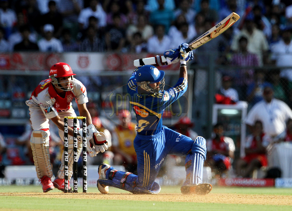 Mumbai Indian player Dinesh Karthik plays a shot during match 28 of the Indian Premier League ( IPL) 2012  between The Mumbai Indians and the Kings X1 Punjab held at the Wankhede Stadium in Mumbai on the 22nd April 2012..Photo by: Vipin Pawar/IPL/SPORTZPICS