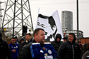 Flag showing an image of Vichai Srivaddhanaprabha as the parade arrives at The King Power Stadium before the Premier League match between Leicester City and Burnley at the King Power Stadium, Leicester, England on 10 November 2018.