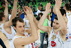 Klemen Lorbek and Saso Ozbolt (31) of Olimpija celebrate after winning the basketball match between KK Union Olimpija (SLO) and Armani Jeans Milano (ITA) in Group D of Turkish Airlines Euroleague, on December 2, 2010 in SRC Stozice, Ljubljana, Slovenia. Union Olimpija defeated AJ Milano 82-75 and qualified to 16 best teams of Euroleague.  (Photo By Vid Ponikvar / Sportida.com)