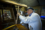 Volunteers working on a part of a Sopworth Strutter under construction by members of the Aviation Preservation Society of Scotland (APSS) at a workshop on the site of the Museum of Flight at East Fortune, Scotland. The project to build the World War I fighter began almost 15 years ago and has involved dozens of men constructing the biplane using original plans. Each part of the aircraft has been individually sourced or crafted to ensure authenticity and it is hoped that it will be completed and be airborne in 2016.