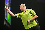 Michael van Gerwen during the Premier League Darts  at the Motorpoint Arena, Cardiff, Wales on 31 March 2016. Photo by Shane Healey.