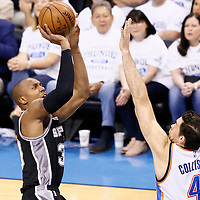 08 May 2016: San Antonio Spurs forward David West (30) takes a jump shot over Oklahoma City Thunder forward Nick Collison (4) during the Oklahoma City Thunder 111-97 victory over the San Antonio Spurs, during Game Four of the Western Conference Semifinals of the NBA Playoffs at the Chesapeake Energy Arena, Oklahoma City, Oklahoma, USA.
