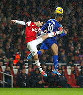Picture by Mike  Griffiths/Focus Images Ltd +44 7766 223933<br /> 01/01/2014<br /> Mikel Arteta of Arsenal and Fraizer Campbell of Cardiff City during the Barclays Premier League match at the Emirates Stadium, London.