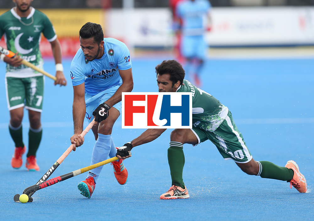 LONDON, ENGLAND - JUNE 24: Harmanpreet Singh of India and Ali Shan of Pakistan battles for possession  during the 5th-8th place match between Pakistan and India on day eight of the Hero Hockey World League Semi-Final at Lee Valley Hockey and Tennis Centre on June 24, 2017 in London, England. (Photo by Steve Bardens/Getty Images)
