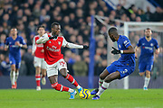 Chelsea defender Antonio Rüdiger (2) tackles Arsenal forward Nicolas Pépé (19) during the Premier League match between Chelsea and Arsenal at Stamford Bridge, London, England on 21 January 2020.