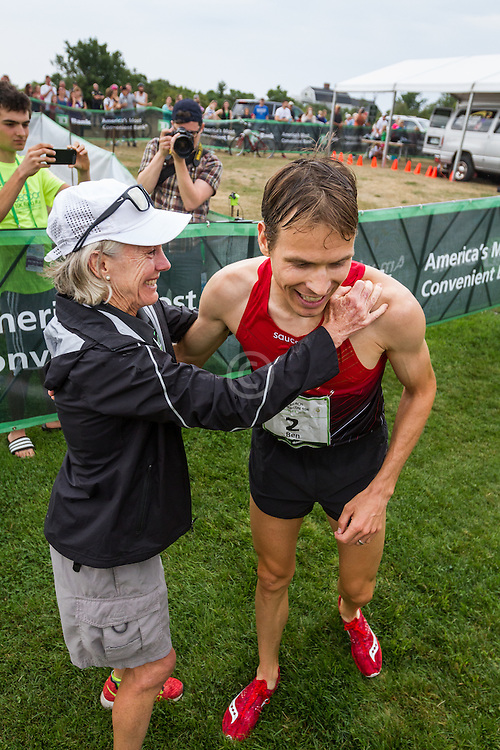 Ben True gets hug from race founder Jaon Samuelson after winning, the first time an American has won the race