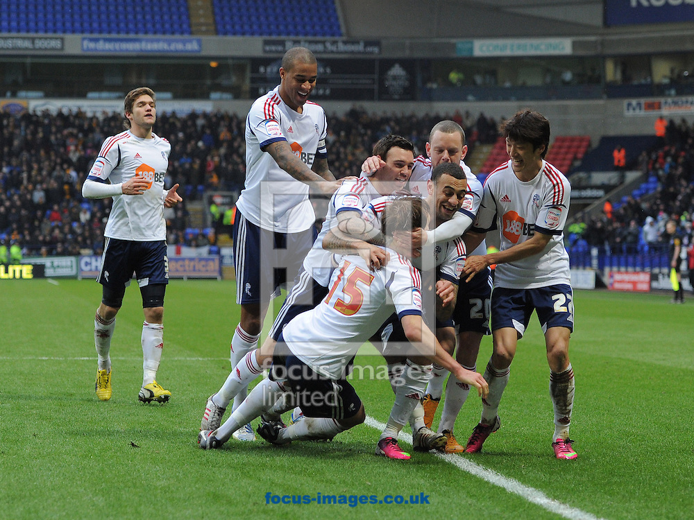 Picture by Alan Wright/Focus Images Ltd 07733 196489.23/02/2013.Craig Dawson of Bolton Wanderers celebrates with team mates after scoring the 4th goal against Hull City during the npower Championship league match at the Reebok Stadium, Bolton.