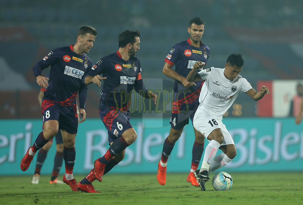 Malemngamba Meitei Kshetri of Northeast United FC fight for ball during match 45 of the Hero Indian Super League between NorthEast United FC and ATK  held at the Indira Gandhi Athletic Stadium, Guwahati India on the 12th January 2018<br /> <br /> Photo by: Arjun Singh  / ISL / SPORTZPICS