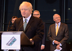 © London News Pictures. 04/05/2012. London, UK. KEN LIVINGSTONE listens to Boris Johnson  make a speech after loosingthe Mayoral electionn. BORIS JOHNSON speaks after being elected as Mayor of London at London City Hall on May 4, 2012. Johnson, a Conservative member of Parliament, defeated Ken Livingstone to become mayor of London for a second term. Photo credit: Stephen Simpson/LNP