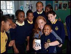 Eastenders actress Patsy Palmer takes a sefie with pupils at Laycock Primary School in Islington, London, as she joins them to take part in London's Biggest Breakfast. Thursday, 22nd May 2014. Picture by Andrew Parsons / i-Images
