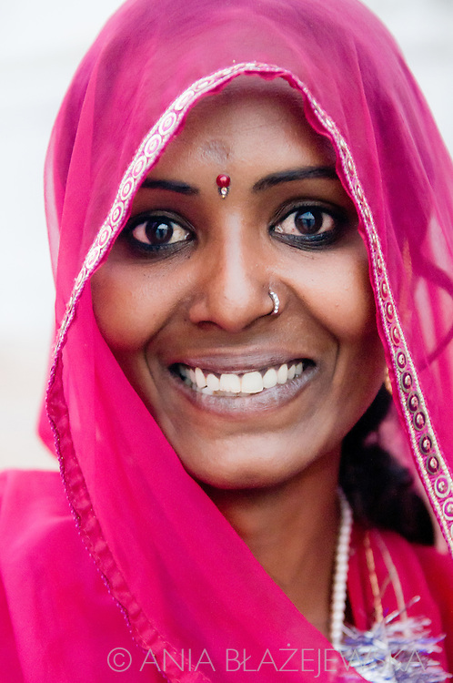India, Pushkar. A portrait of a beautiful girl wearing a pink sari, whom I met in Pushkar, where she came from a little village situated near Jaisalmer.