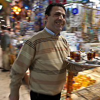 A tea vendor swirls through Istanbul's Grand Bazaar bringing tea to the merchants.