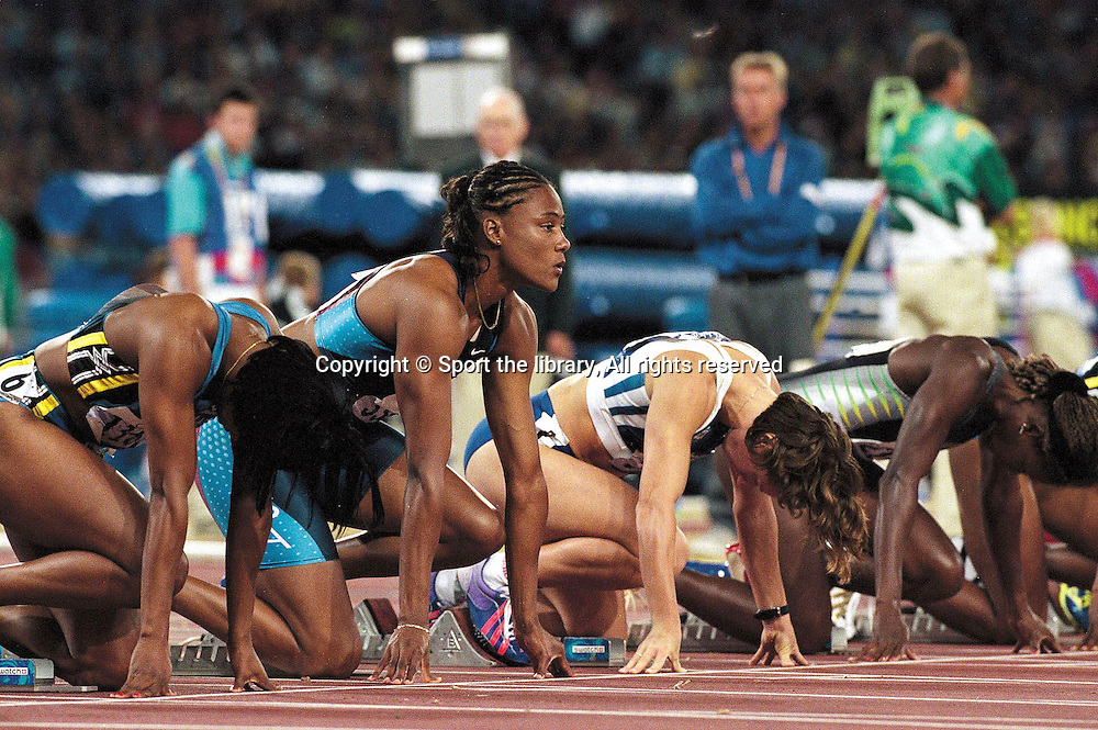 &copy; Sport the library/SI/Heinz Kluetmeier/ Photosport<br /> Olympics-Summer, Sydney Australia 2000<br /> Track &amp; Field- Womens 100m Final<br /> Marion Jones, USA, gold<br /> 2000 Summer Olympics, Sydney Day 08<br /> Olympic Stadium/Sydney, NSW, AU 09/23/00<br /> SetNumber: X61312 TK18 R1 F25